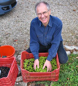 Nigel with some crates of olives