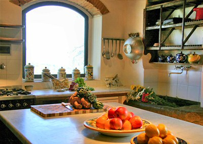 The Kitchen - food preparation area with traditional stone sink